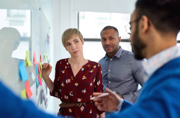 Diverse team of creative millennial coworkers in a startup brainstorming strategies stock photo