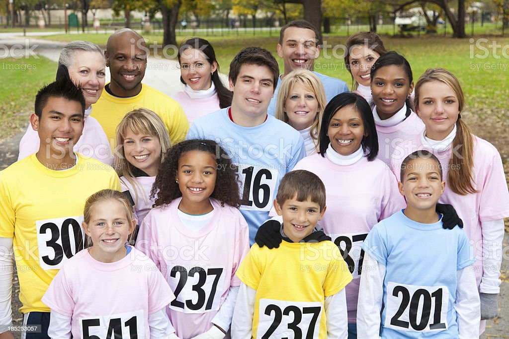 Diverse team of people at a charity race event royalty-free stock photo