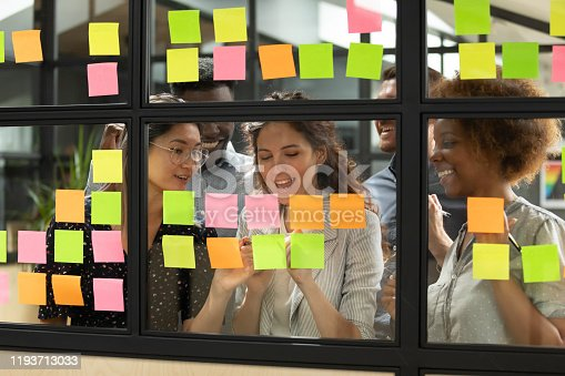 1144569896 istock photo Diverse teammates satisfied with working process at office. 1193713033