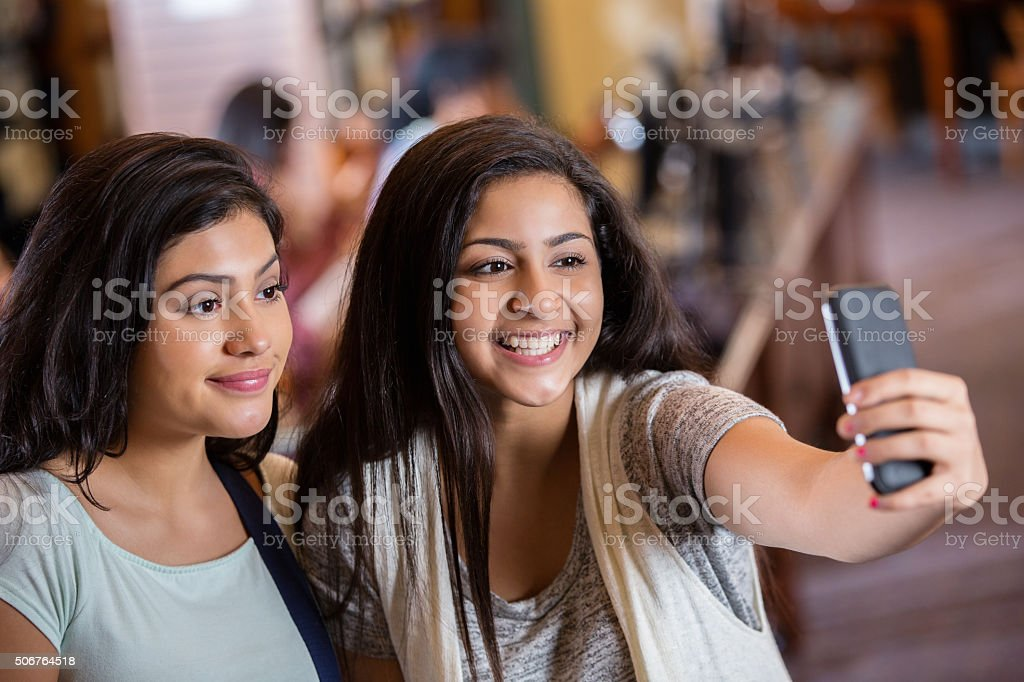 Sarkari Niyukti https://nimsuniversity.org/nu/ Sarkari Niyukti - Government Jobs in India - सरकारी नियुक्ति | Image Courtesy - https://media.istockphoto.com/photos/diverse-teen-girls-taking-selfie-photo-with-phone-in-library-picture-id506764518