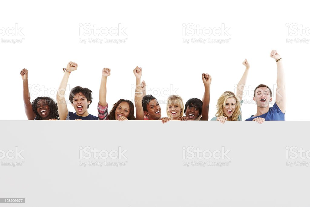 Diverse Teens Celebrating Behind a Blank Sign - Isolated royalty-free stock photo