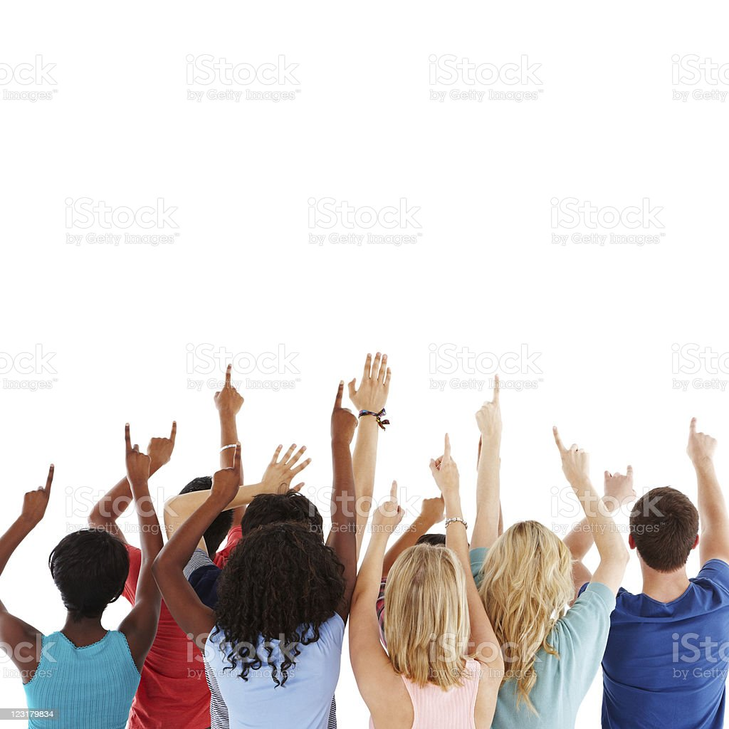Diverse Teens Pointing to the Sky - Isolated stock photo