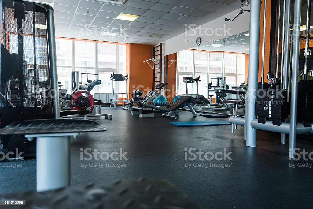 Diverse training equipment at the gym room stock photo