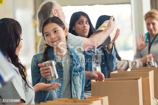 istock Diverse volunteers packing boxes at food drive 510150986