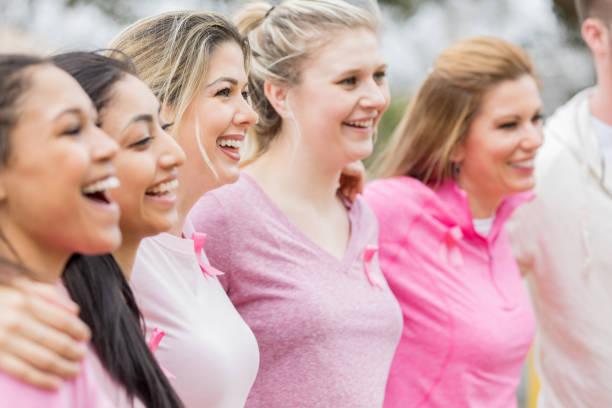 kanser farkındalık bağış sırasında çeşitli kadın - breast cancer awareness stok fotoğraflar ve resimler