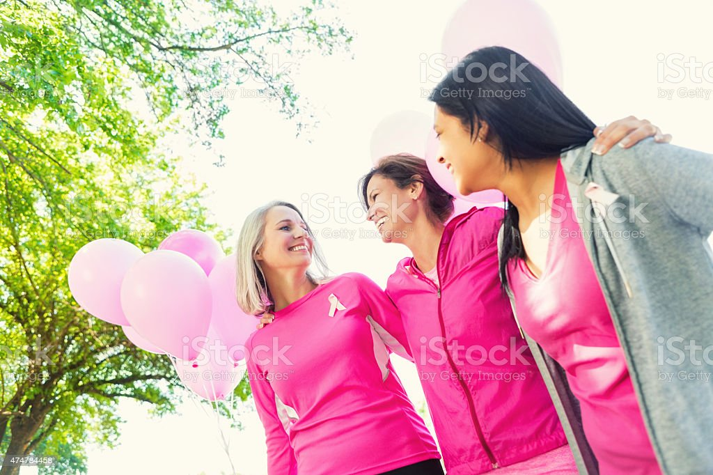 Diverse women in breast cancer awareness charity race stock photo