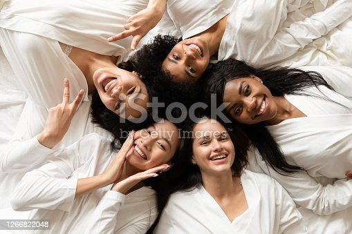 istock Diverse women lying in bed feels happy after spa procedures 1266822048