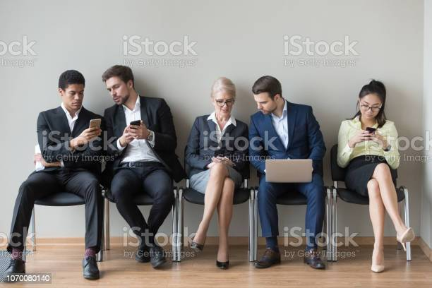Diverse work candidates sit in queue using gadgets before interview picture id1070080140?b=1&k=6&m=1070080140&s=612x612&h=z8iqawpo5nrsgtpfsqlpzicbesneotus6w1e 56u9so=