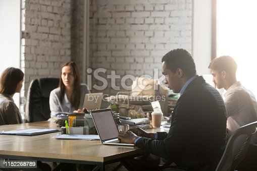 1124783373 istock photo Diverse workers having busy workday at shared office 1152268789