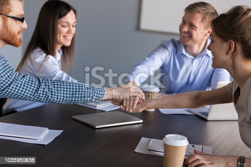 istock Diverse workers joining hands on stack during teambuilding 1033950638
