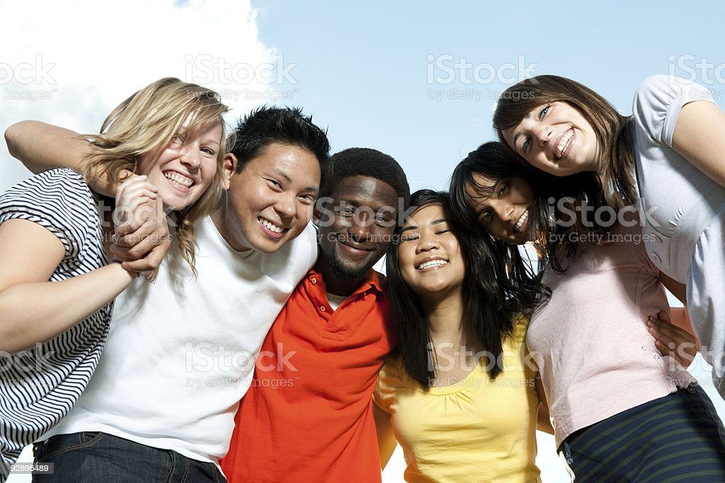 Diverse young adults outside stock photo
