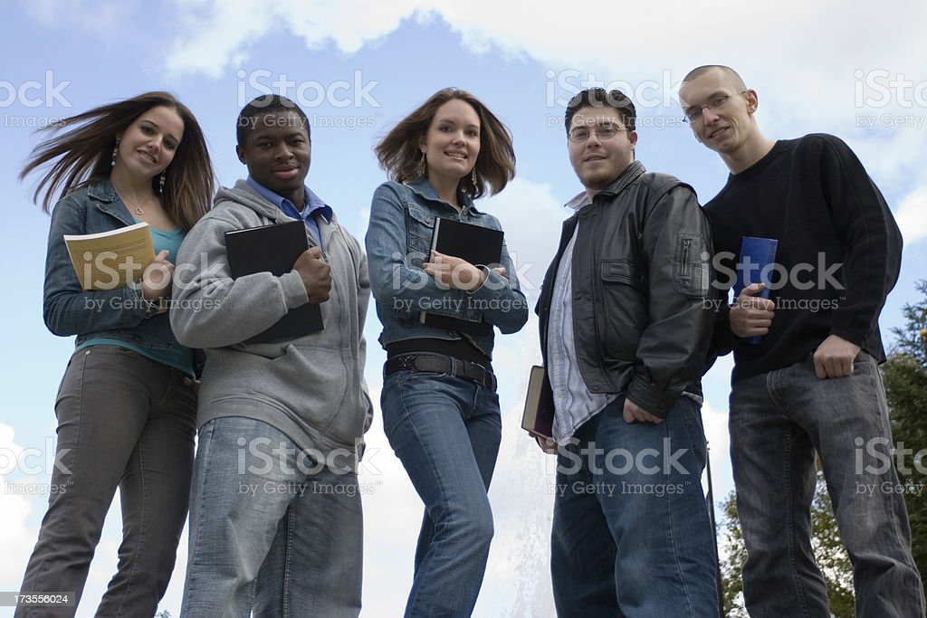 Diversified students holding books. royalty-free stock photo