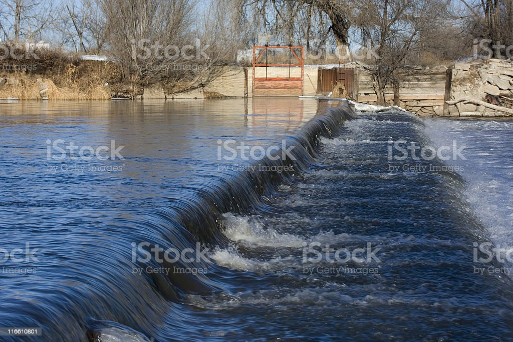 diversion dam on a river royalty-free stock photo