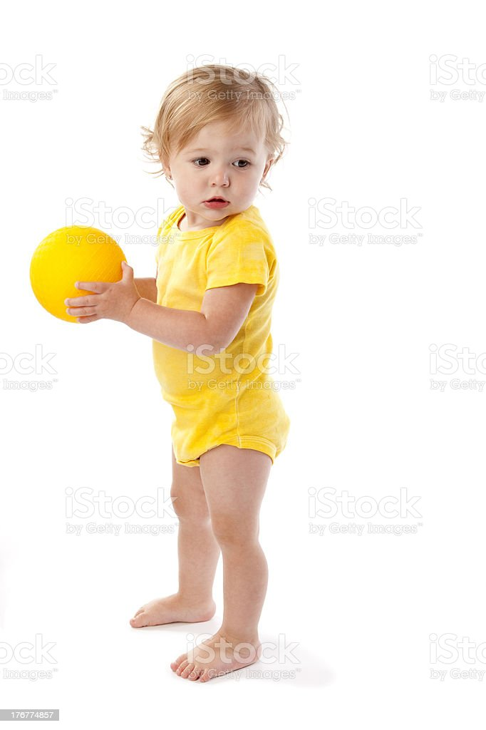Diversity: Caucasian Toddler Plays With Yellow Ball royalty-free stock photo
