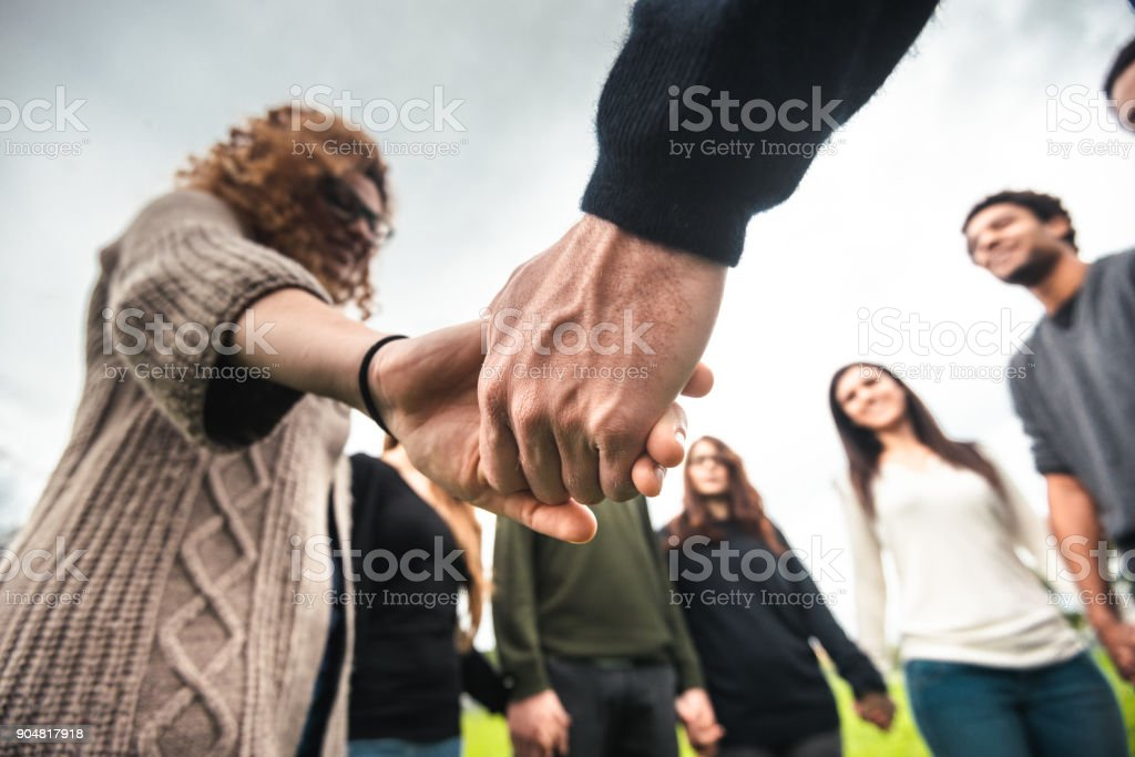 diversity concept  - holding hands stock photo