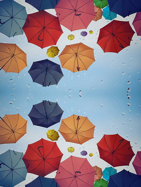 Diversity concept with multicolored umbrellas as background
