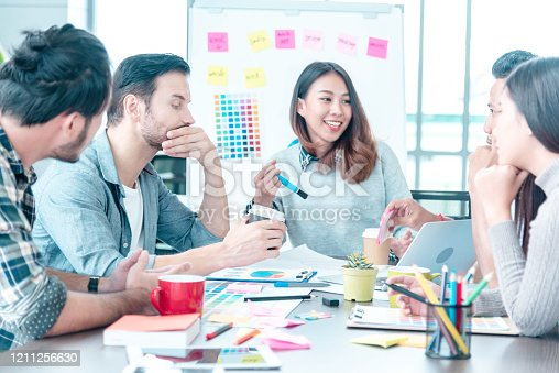 842214506 istock photo Diversity Creative Design Collaboration Team Meeting Communication with Business Partners Teamwork Working Together in Conference Room. Group of young people Meeting Trust in Businessman and Team. 1211256630