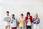 Diversity Friends Using Digital Devices Concept