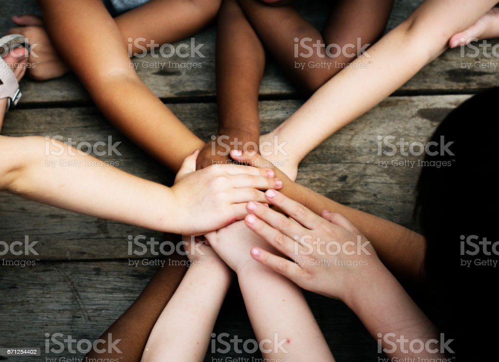 Diversity Group Of Kids Put Hands Together stock photo