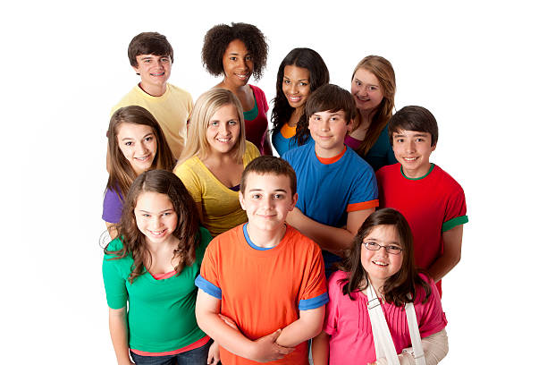 Diversity: Group of Multi-Racial Teenagers Friends Teamwork A high angle view of a multi-racial group of teenage girls and boys in colorful clothing standing together as a team. teenagers only stock pictures, royalty-free photos & images