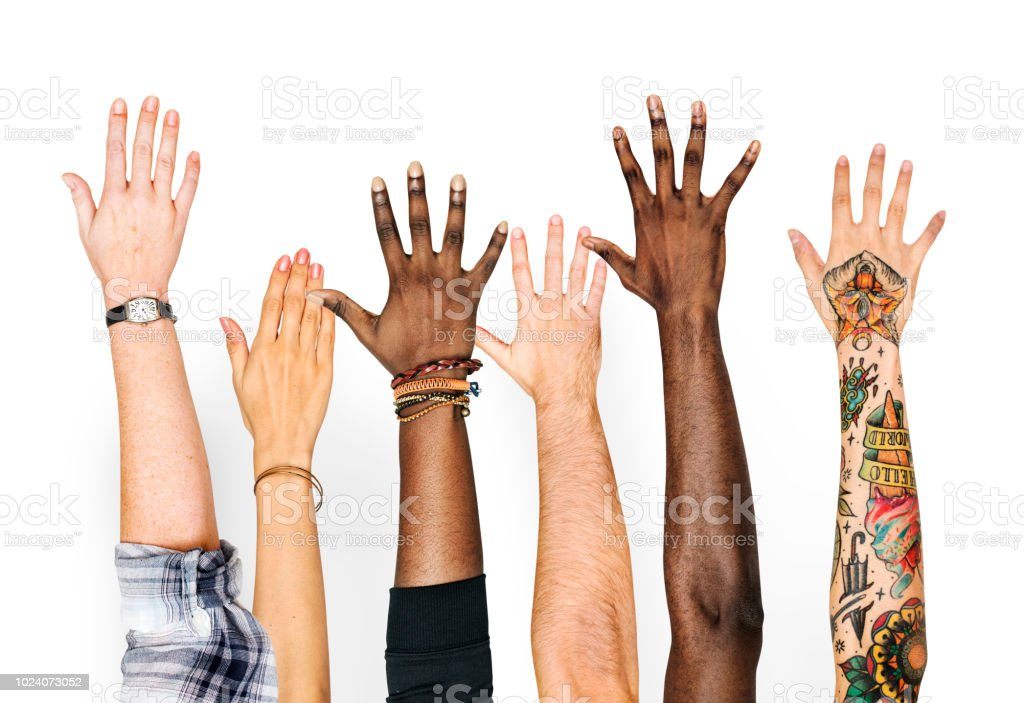 Diversity hands raised up gesture stock photo