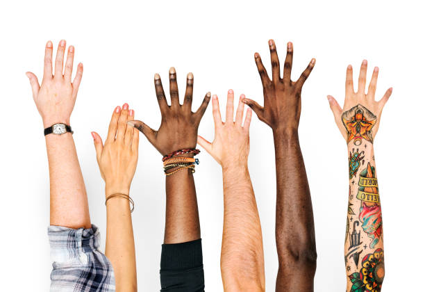 diversity hands raised up gesture - vote sign stock photos and pictures