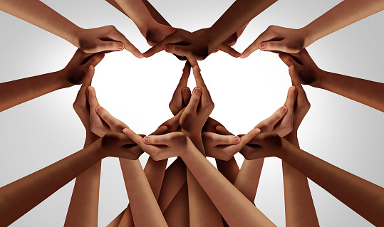 Diversity love and unity partnership as heart hands in groups of diverse people connected together shaped as an inclusion and inclusive support symbol of teamwork and togetherness.