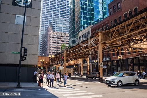 istock Diversity on Chicago Loop corner of Franklin & Lake as people wait for crosswalk to clear during rush hour 1167297401