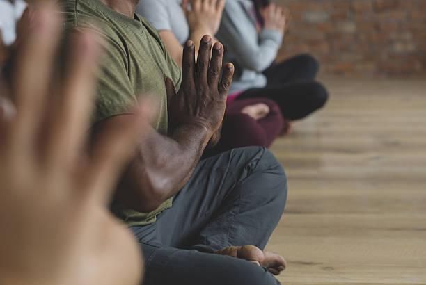diversity people exercise class relax concept - meditationsräume stock-fotos und bilder