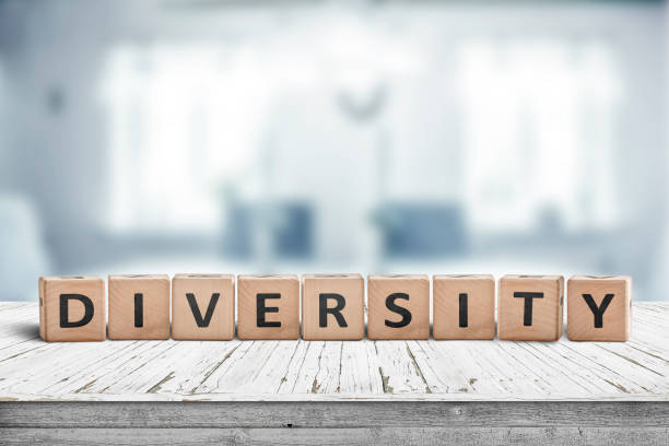 Diversity word sign on a wooden desk stock photo
