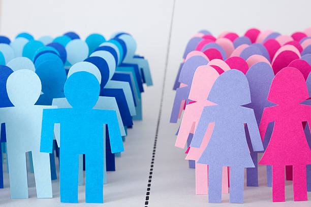 Divided men and women stock photo