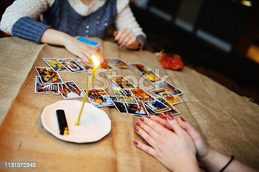 istock Divination by the Tarot cards. The fortune teller predicts the f 1131372343