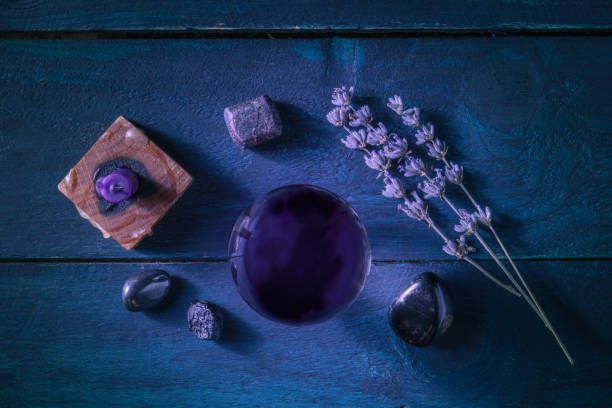 Divination. Magic ball with herbs, crystals and a candle, shot from the top. stock photo