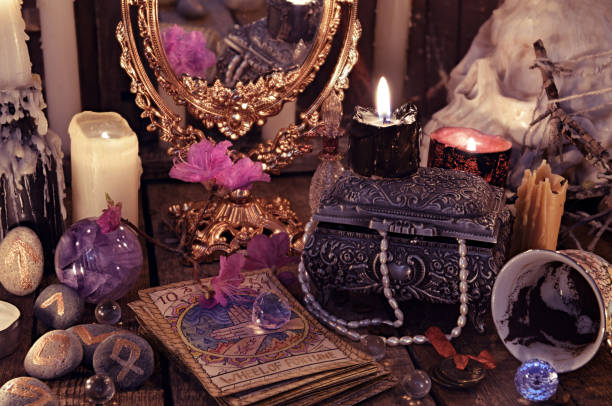 Divination rite with the tarot cards, flowers and mystic objects stock photo