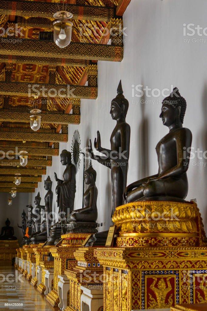 Divine lineup of Buddhas stock photo