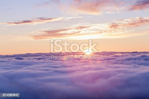 istock Divine sunset above the clouds 524380842