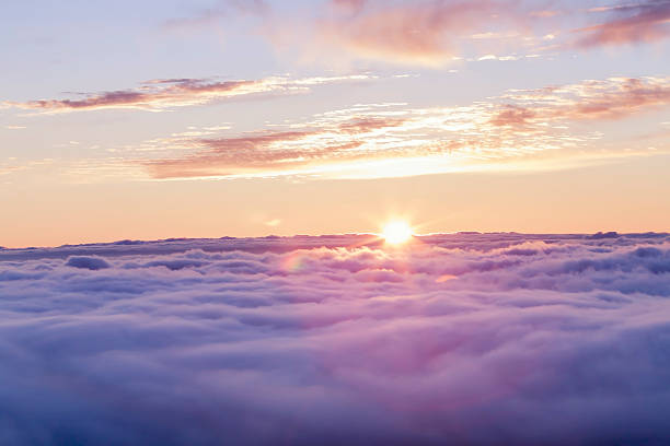 divine sunset above the clouds - soft focus stock photos and pictures