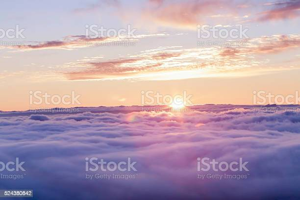 Photo of Divine sunset above the clouds