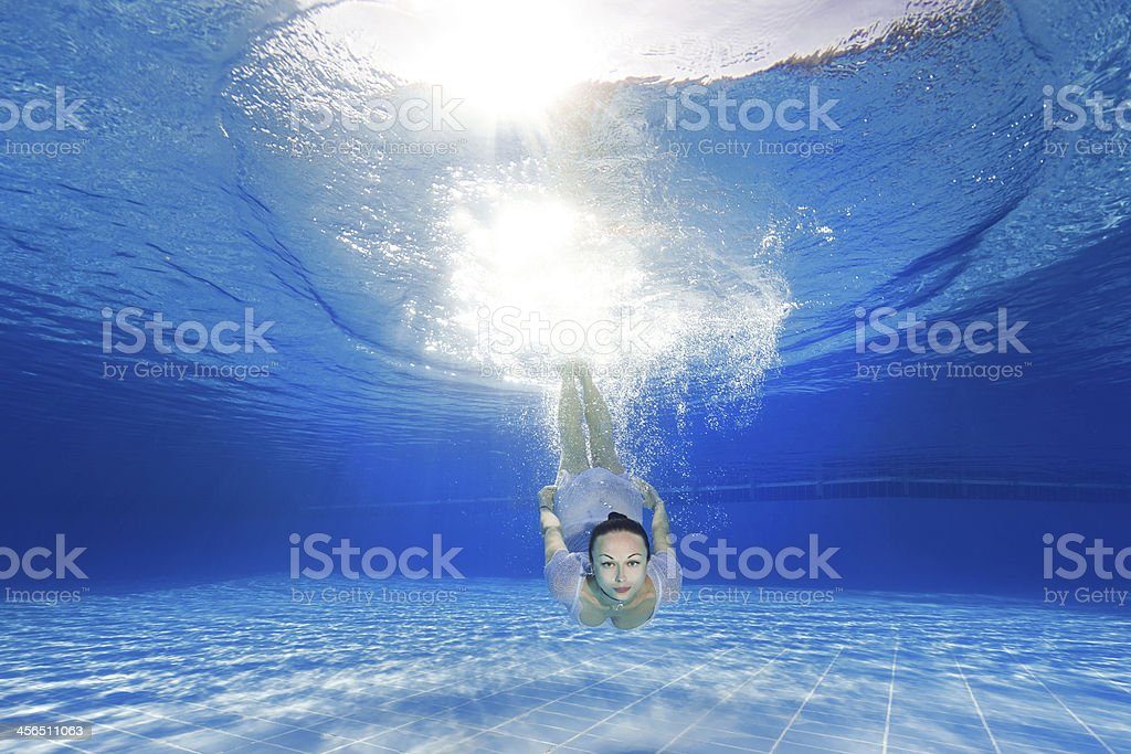 diving beautiful girl stock photo