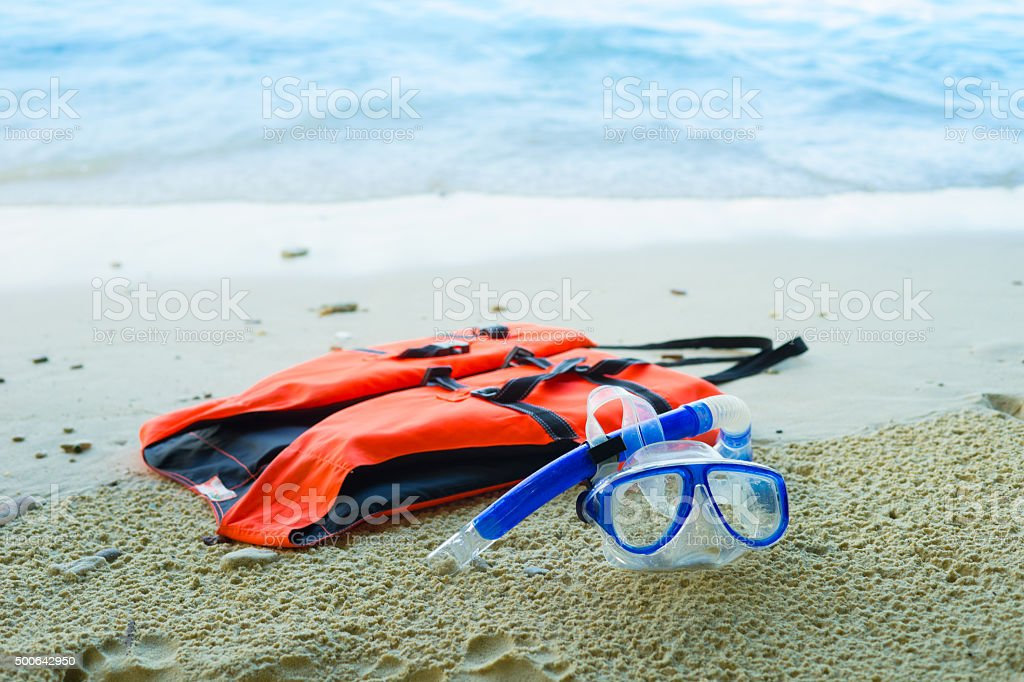 Diving Goggles and Snorkel Gear near beach stock photo