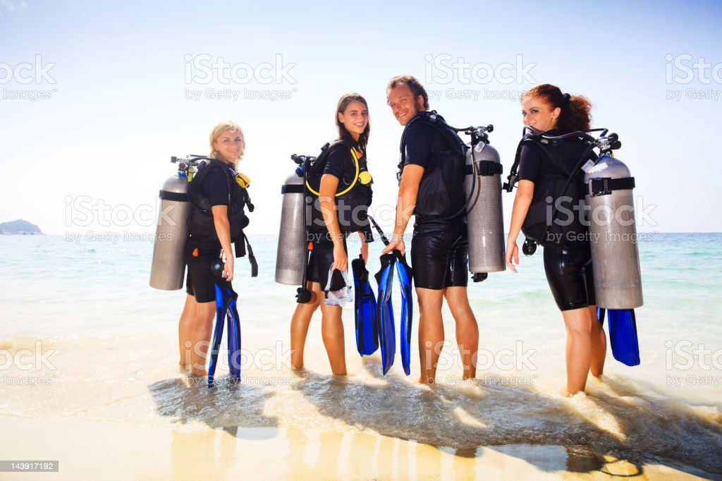 Diving group turning towards the camera. royalty-free stock photo