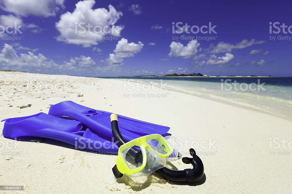 Diving mask, snorkel and fins on a tropical sand beach stock photo