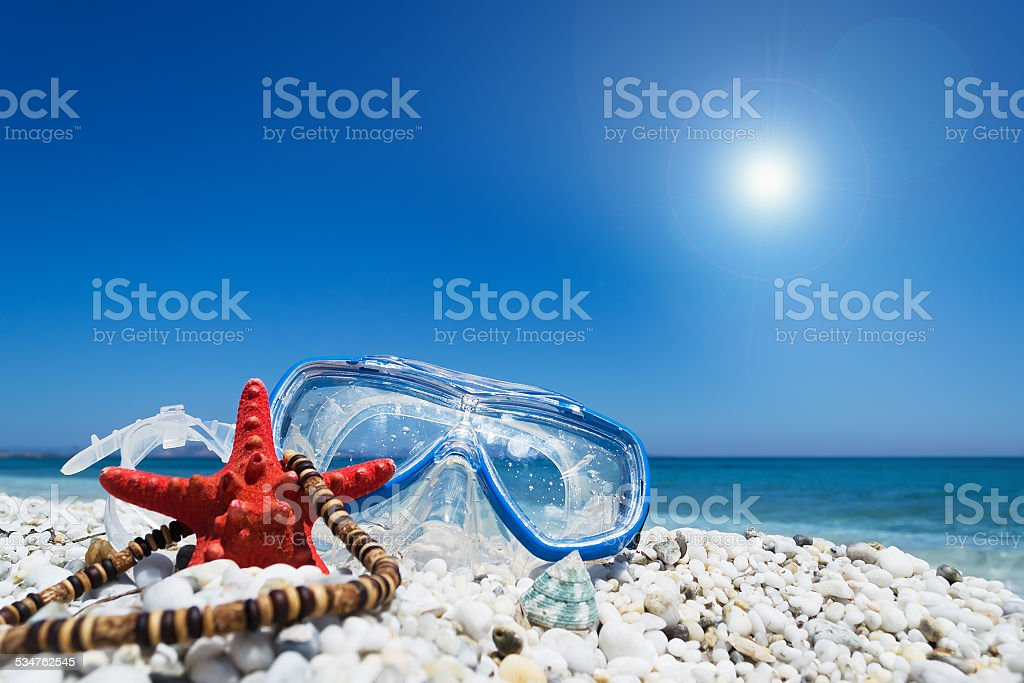 diving mask under a shining sun stock photo
