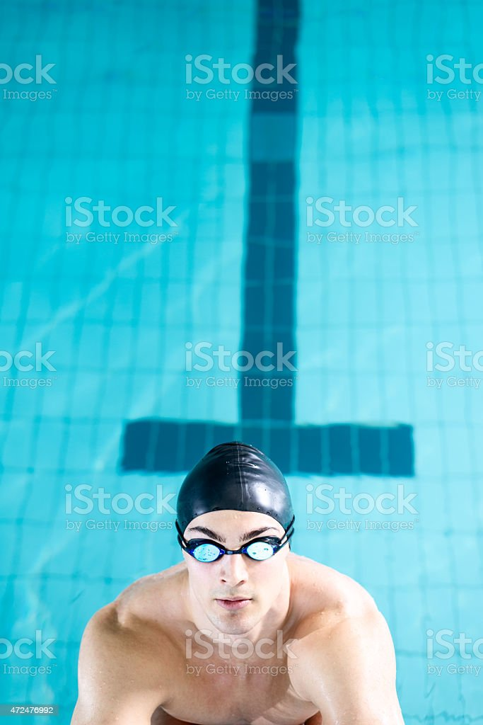 Diving off the starting block stock photo