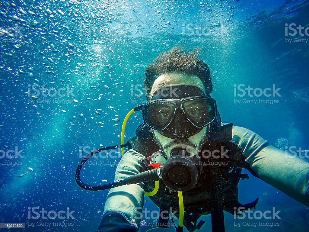 Diving. Self portrait of diver in the sea. stock photo