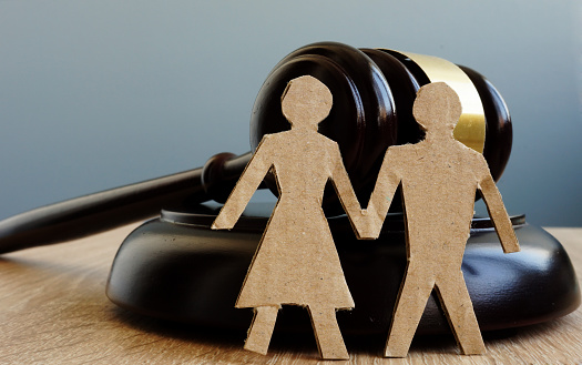 istock Divorce and alimony. Relationship problems. Gavel and figures of couple. 996346316