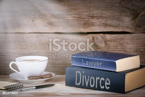 istock Divorce and Lawyer. Stack of books on wooden desk 652379902