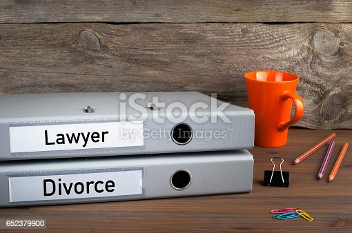 istock Divorce and Lawyer - two folders on wooden office desk 652379900
