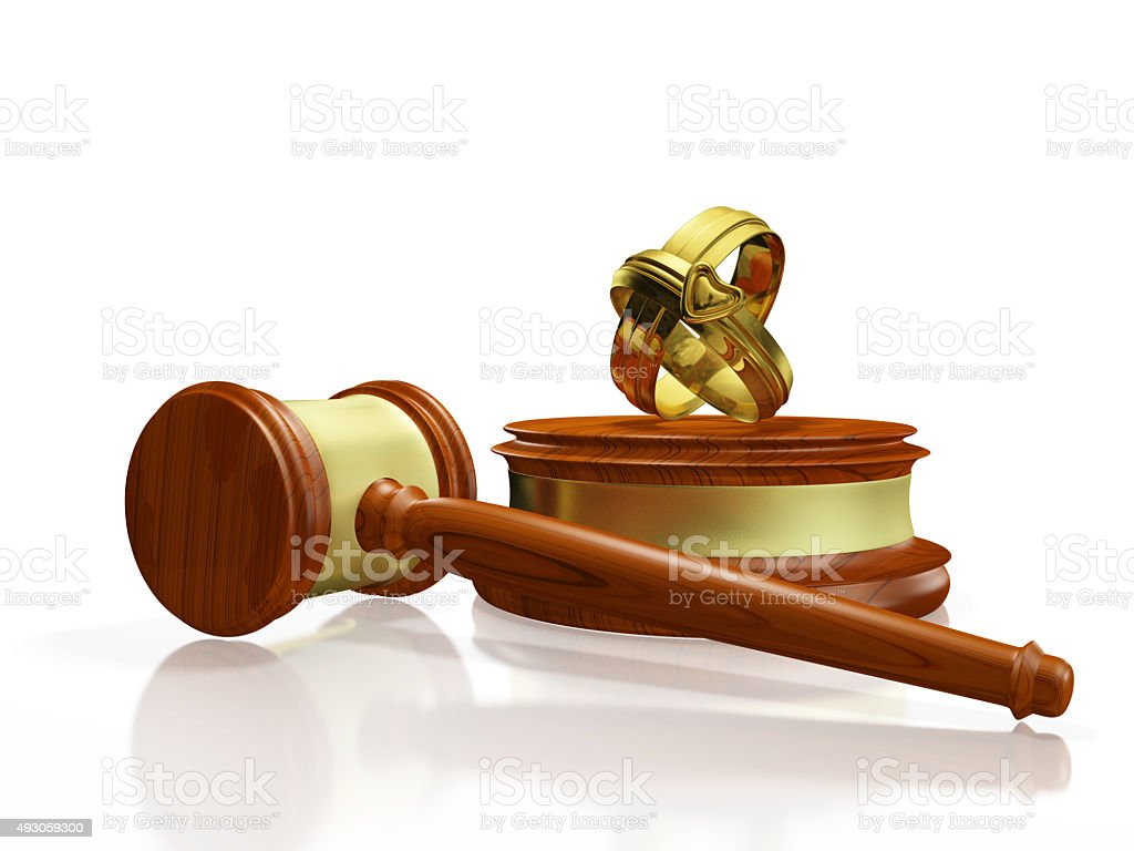 Divorce Concept Gavel and Wedding Bands stock photo