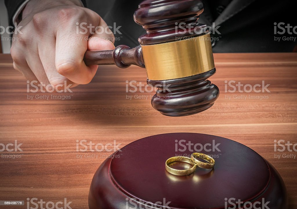 Divorce concept. Hand of judge in courtroom is holding gavel. stock photo
